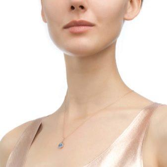 Золотой кулон (79 фото): модели для женщин из белого золота с бриллиантом, женские кулоны в виде ключика