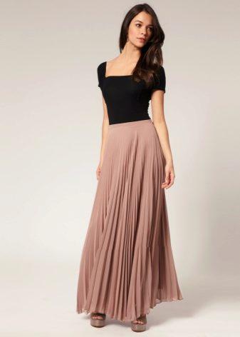 87021fbd692 Длинные юбки трапеции чаще всего ассоциируются у всех с романтичным  образом. Подобная ассоциация происходит из-за женственного и элегантного  силуэта.
