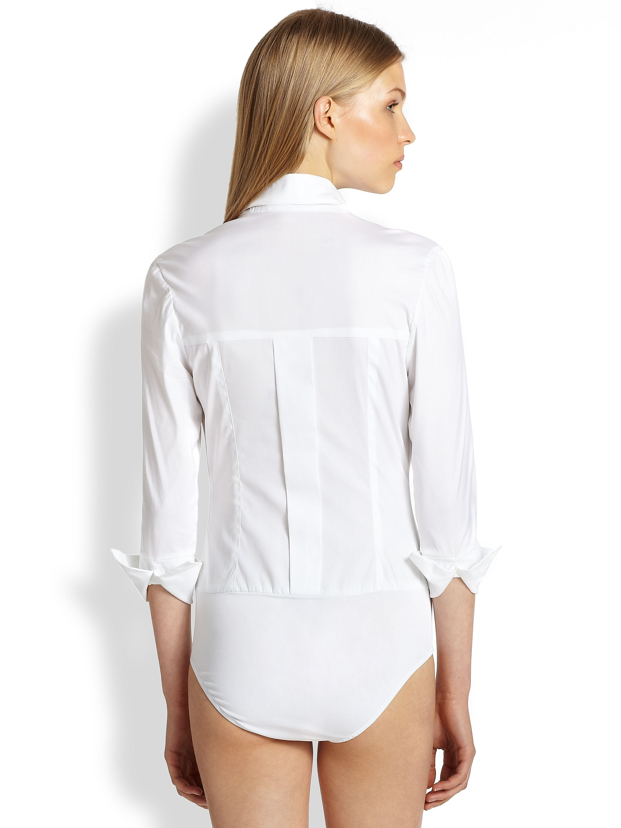2b2cbc332e02 Классического кроя однотонные брюки и юбки-тюльпаны станут стильным  дополнением к таким блузам. Наличие в гардеробе трех-четырех блузок-боди  разных цветов ...