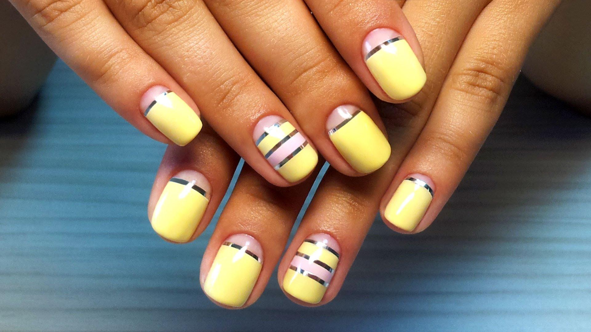 Дизайн желтым лаком на коротких ногтях