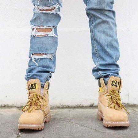 Символом стали желтые ботинки этой марки. Популярные изделия носят студенты,  рабочие, спортсмены – все люди, которые ценят свободу движений, удобство,  ... 94bb5bdf42a