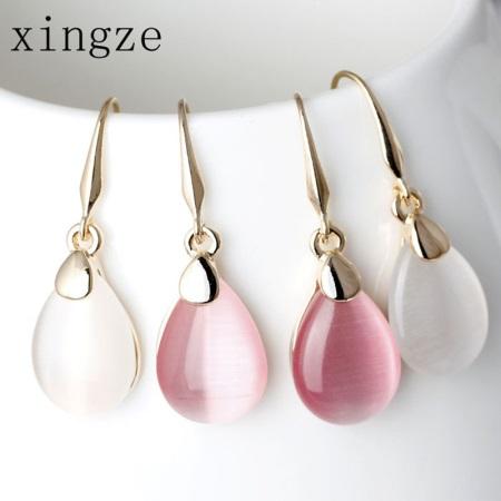 Серьги с розовым кварцем: классические модели из серебра и золота, серебряные сережки с дымчатым камнем